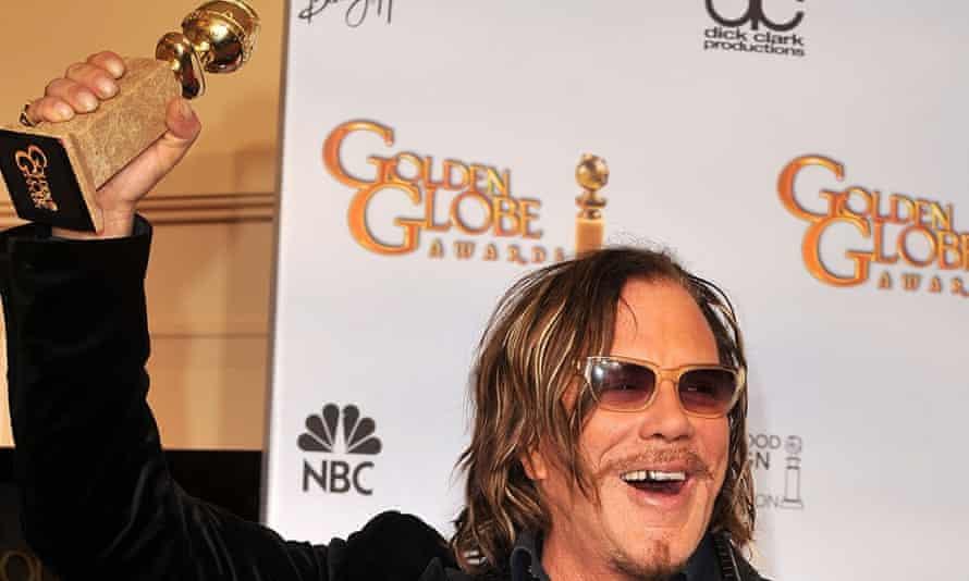 Mickey Rourke with his Golden Globe for The Wrestler, in 2009.