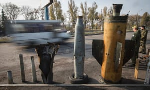 Makievka, Ukraine A bus drives past remains of munitions, which locals said were used by Ukrainian government forces. Evidence collected by Human Rights Watch suggests government forces have used cluster munitions in eastern Ukraine and pro-Russian separatists may also have done so