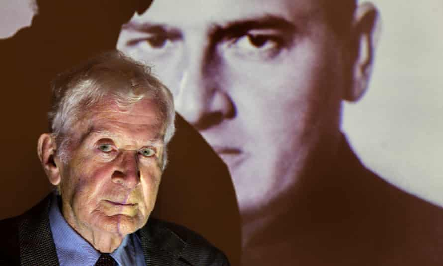 Siegfried Ramler in front of a projection of Hans Frank, the 'Butcher of Warsaw'.