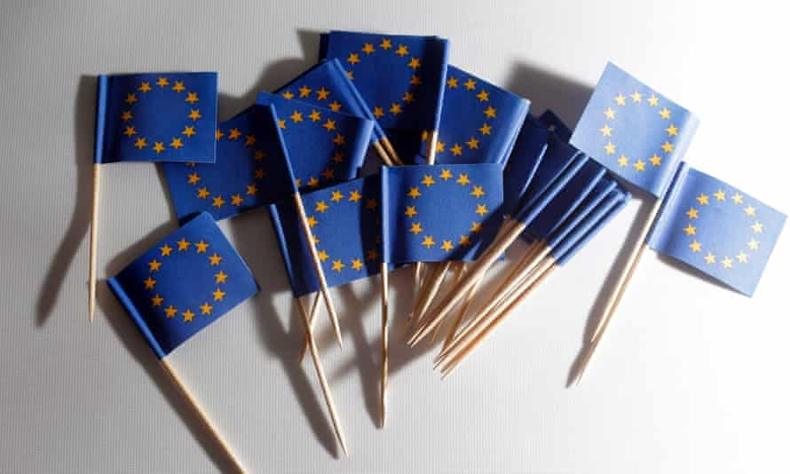EU flags on toothpicks lie on a table during a photo opp at a flag store in Vienna, Austria.