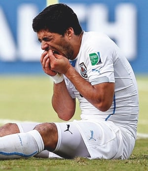 Luis Suárez holding his teeth after biting Giorgio Chiellini at this year's World Cup