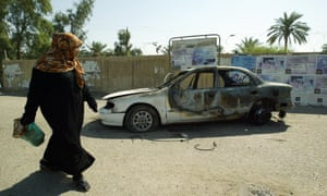 A burnt car on the site where Blackwater guards who were escorting US embassy officials opened fire in 2007.