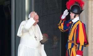A Swiss Guard salutes Pope Francis at the Vatican
