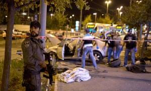 An Israeli policeman stands on guard nea