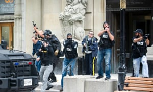mergency responders escort VIPs out of a building on Sparks Street near the Post Office after a gunman shot a soldier as he was standing guard at the National War Memorial in Ottawa, Canada
