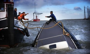 The remnants of Hurricane Gonzalo have caused havoc across the northern European coastline, including in the Harlingen harbour where rescuers tried to save boats, battered by the strong winds