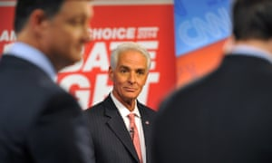 Democratic candidate Charlie Crist, center, waits for a question before his live debate with Republican governor Rick Scott on Tuesday.