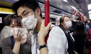 People wear masks in Hong Kong during the Sars outbreak in 2003.