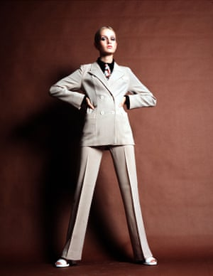Twiggy is pictured in a cream trouser suit in 1968.