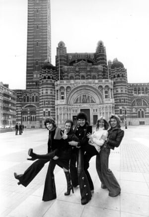 4th March 1976:  Pop singer Alvin Stardust, centre, with members of the singing dance troupe 'Guys And Dolls' outside Westminster Cathedral, London, where they have been rehearsing for a concert.