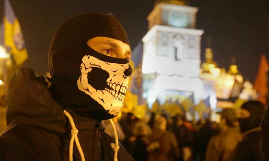 A supporter of Ukrainian nationalists attends a rally in front of St Michael's golden-domed monastery in Kiev, Ukraine, on 14 October 2014.