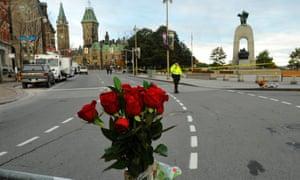 Flowers adorn a barricade around the war memorial in Ottawa.