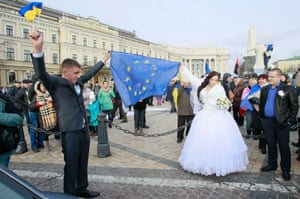 Ukranine newly weds attend a rally held by supporters of EU integration in Kiev in November 2013.