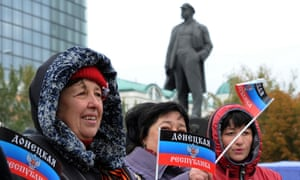 Women wave the separatist Donetsk People's Republic's flag at its presentation on Lenin square in Donetsk in eastern Ukraine last week.