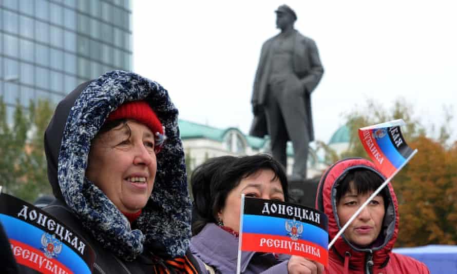 Women wave the separatist Donetsk People's Republic's flag at its presentation on Lenin square in Donetsk in eastern Ukraine last week.