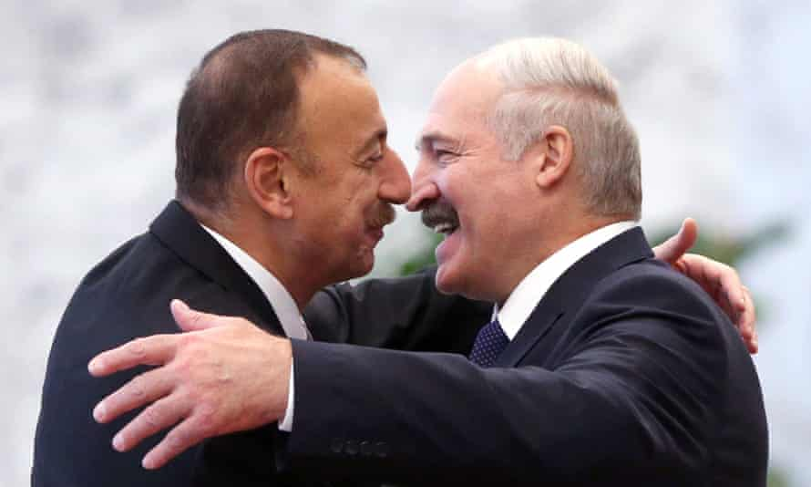Azeri President Ilham Aliyev (left) greets Belarusian President Alexander Lukashenko (right) during the Summit of the Commonwealth of Independent States (CIS) in Minsk on 10 October, 2014 in Minsk, Belarus.