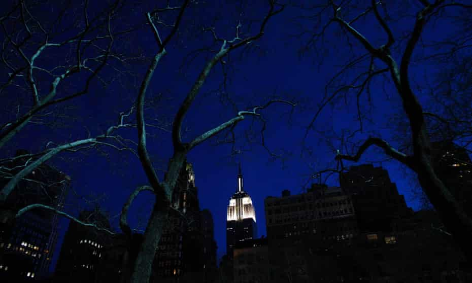 The Empire State Building is seen lit up before Earth Hour in New York, during which lights were turned off for one hour to show support for renewable energy.