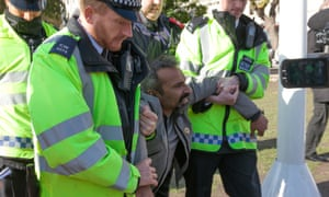 Police remove a protester from Parliament Square