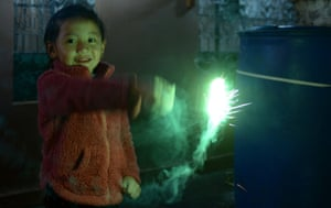 Thimphu, Bhutan A child plays with a sparkler ahead of the festival