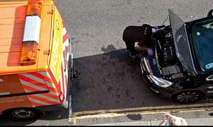RAC patrolman attends to broken-down car