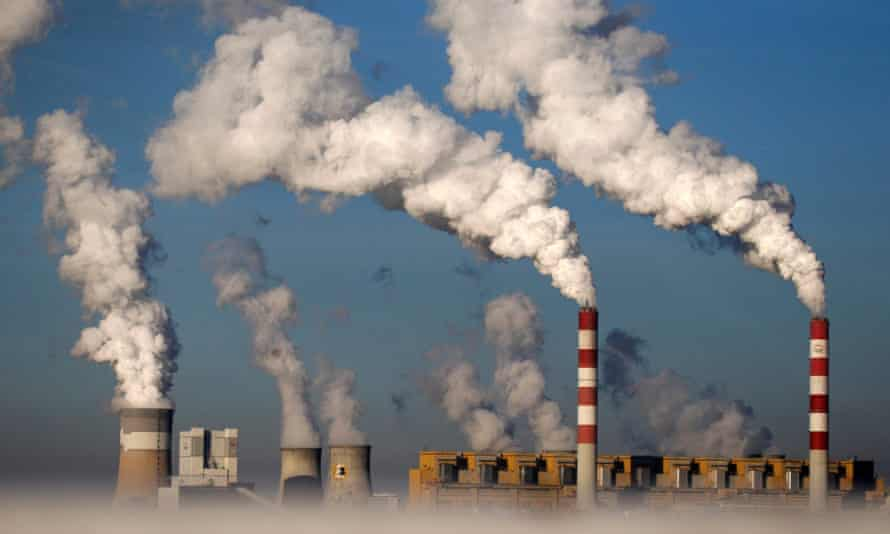 Smoke billows from the chimneys of a coal-fired Polish power plant.