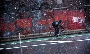 Cyclist on wintery street.
