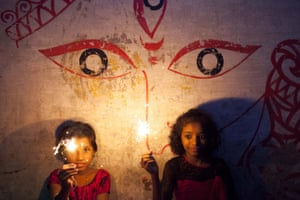 Children play with sparklers in Dhaka