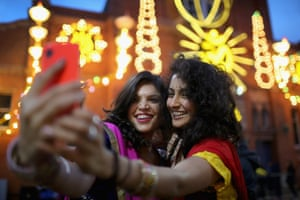 Aanka Batta and Kelly Vaduka take a selfie in front of illuminations
