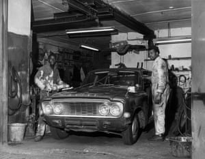 Migrants from the Caribbean at work in a garage, after coming to England to fill a man power shortage in 1969