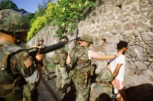 US soldiers arrest a suspected Marxist activist in the capital of Grenada, three days after they invaded the island in 1983