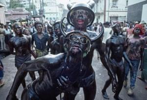Carnival revelers  adorned with dead snakes in Grenada 1984