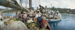 Shoppers search for supplies and fruit on a schooner from Puerto Rico in the Virgin Islands 1968