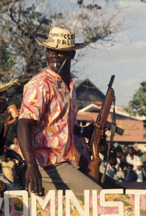 An armed Tonton Macoute patrolling the streets of Port-au-Prince, Haiti 1980