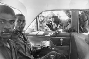 A man points a handgun through a car's open window during the civil uprising in the Dominican Republic 1965t