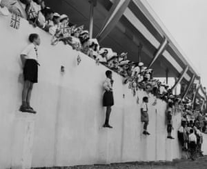 Crowds wait in Trinidad and Tobago for the arrival of Princess Margaret in 1955