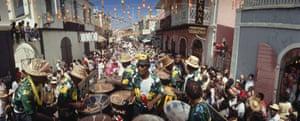 US VIRGIN ISLANDS - JANUARY 01: A calypso band plays on Main Street during a Transfer Day parade, Charlotte Amalie, Saint Thomas Island, Virgin Islands 1968