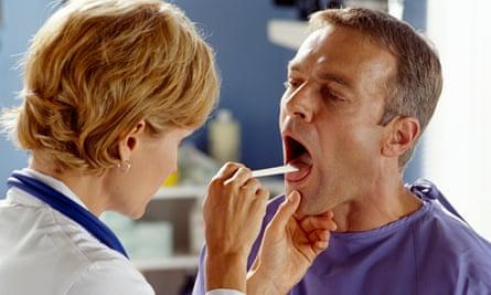 Doctor examining patient's throat