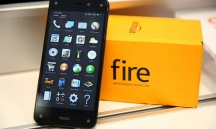 An Amazon Fire Phone on show at an AT&T store in Brooklyn: many are still in their boxes, Amazon's writedown suggests.
