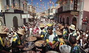 """A calypso band plays on Main Street during a Transfer Day parade"""