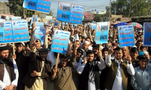 Protesters hold placards and shout slogans against the Afghanistan Express, in Jalalabad.
