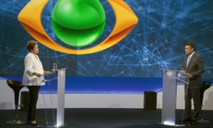Candidates for President of Brazil, the ruling Workers Party (PT), Dilma Rousseff (L), and opposition Party of Brazilian Social Democracy (PSDB), Aecio Neves (R), shake hands before the start of the first of four television debates.