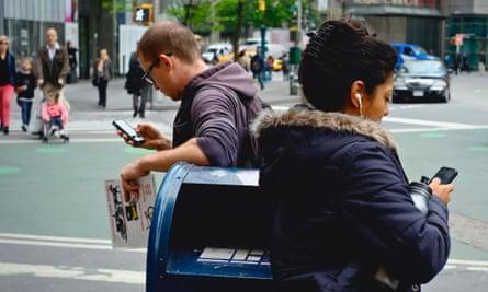 People on smartphones in New York City