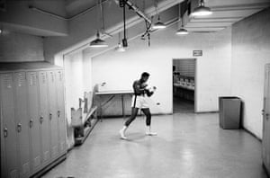 This shot witnesses a pre-fight scene where Ali is poised with anticipation. His outline is so distinctive – it reminds me of the famed image of Ali underwater by Flip Schulke. Notice, also, the shadowy figure in the toilet behind Ali; at first I questioned whether he spoiled Ali's solitude, but I grew to like the subtle detail of their twinning.
