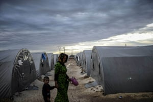 Photographer Bulent Kilic continued his powerful reportage from the Turkish-Syrian border town of Suruc. Here, Kurdish people walk in a refugee camp early in the morning. US President Barack Obama and his Turkish counterpart Recep Tayyip Erdogan pledged to step up the fight against the Islamic State group in Syria