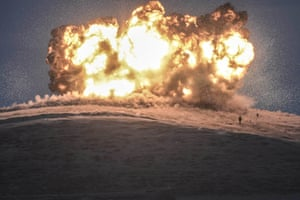 And here, in another photograph from Kilic, Islamic State militants stand before the explosion of an air strike on Tilsehir hill near the border
