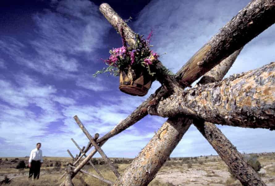 A basket of flowers hangs from the fence where Matthew Shepard was left tied and beaten