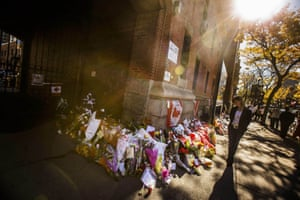 A woman stands at a memorial in honour of Cpl Nathan Cirillo outside the Lieutenant-Colonel John Weir Foote Armoury in Hamilton. A gunman attacked Canada's parliament with gunfire erupting near to a room where prime minister Stephen Harper was speaking. Cirillo was fatally shot at the nearby Canada War Memorial