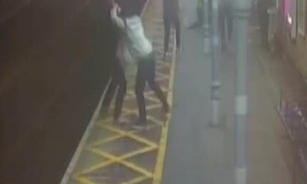 Still taken from CCTV footage of a registered blind man being pushed onto the tracks during a violent assault at a Chelmsford station.