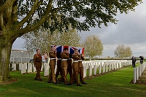 Soldiers of the Fourth Battalion, the Yorkshire Regiment, carry the coffin of an unknown soldier during the re-interment of the remains of 15 British soldiers of the York and Lancaster Regiment who died one hundred years ago during the first world war at Bois Grenier, France.