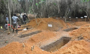 Grave diggers prepare burial sites for Ebola victims on the outskirts of Monrovia, Liberia